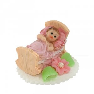 Bobas w łóżeczku różowy - dekoracja tortu na chrzest