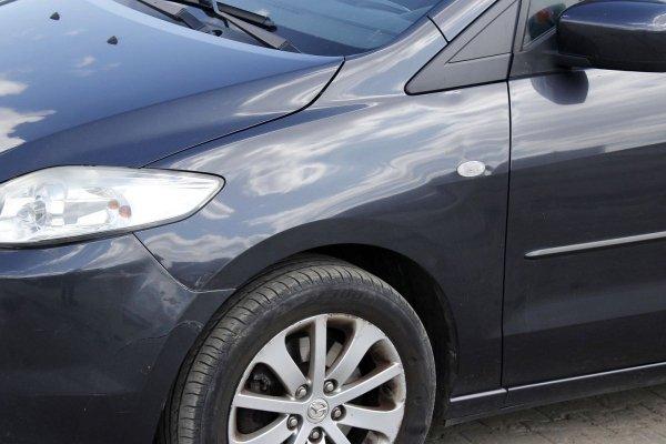 Błotnik przód lewy Mazda 5 CR 2005
