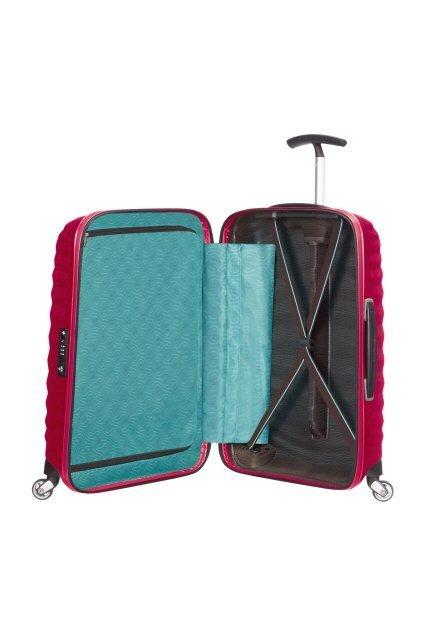 Bagaż wewnątrz posiada materiałową przekładkę zapinaną na suwak oraz pasy spinajace ubrania po jednej stronie