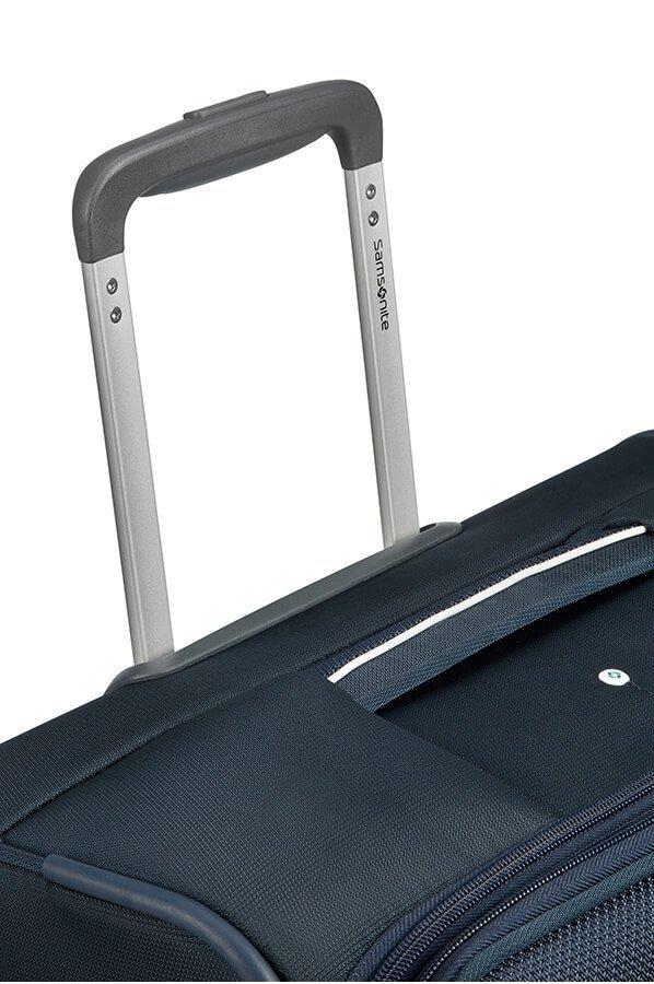 Bagaż posiada stopniowany wyciągany stelaż, górny i boczny uchwyt
