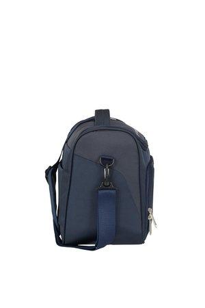Kuferek posiada długi pasek na ramię i uchwyt u góry i zewnętrzną kieszeń