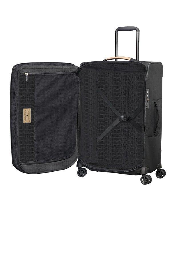 Bagaż wewnątrz posiada pasy spinające ubrania oraz uchwyty na pasy, dzięki którym po spakowaniu nie szukamy ich pod ubraniami