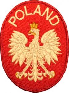 emblemat Godło RP w czerwonym polu tarczy, powyżej napis POLAND