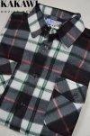 Koszula polarowa czarno-biała w kratkę.