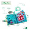 LILLIPUTIENS Mini-książeczka wielofunkcyjna z szeleszczącą folią i gryzakiem Lemur George 6 m+