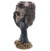 łapa smoka trzymająca w szponach czaszkę rycerza gotyckie kielichy