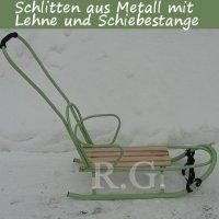 Schlitten aus Metall mit Rückenlehne Schiebestange in grün