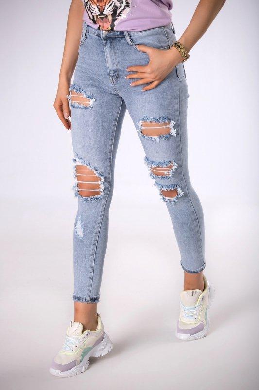 jeansy slim z dziurami