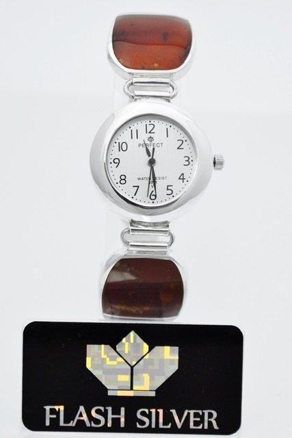 Wyjatkowy zegarek srebrny z bursztynem