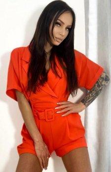 Elegancki kombinezon damski pomarańczowy